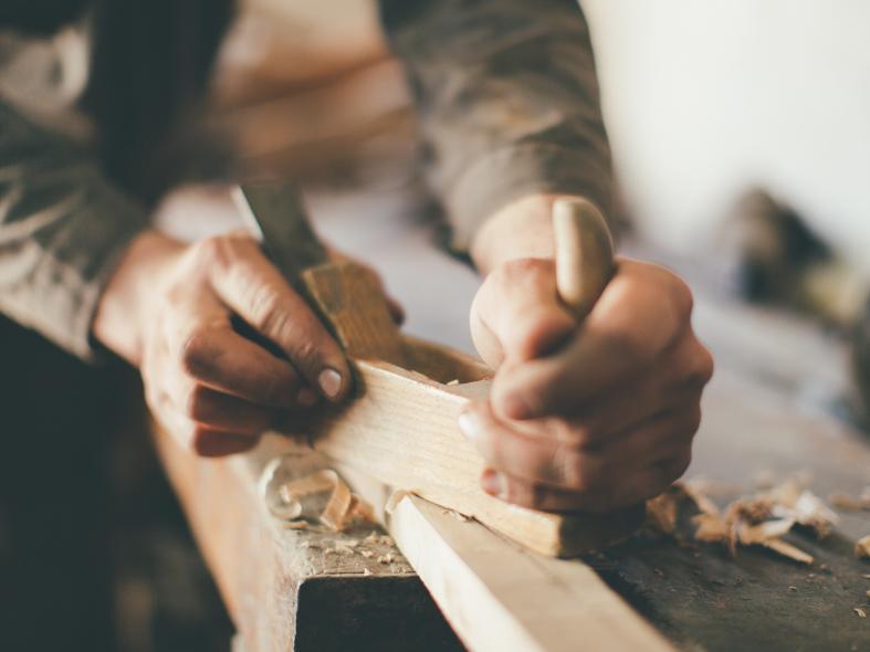 Person plaining wood